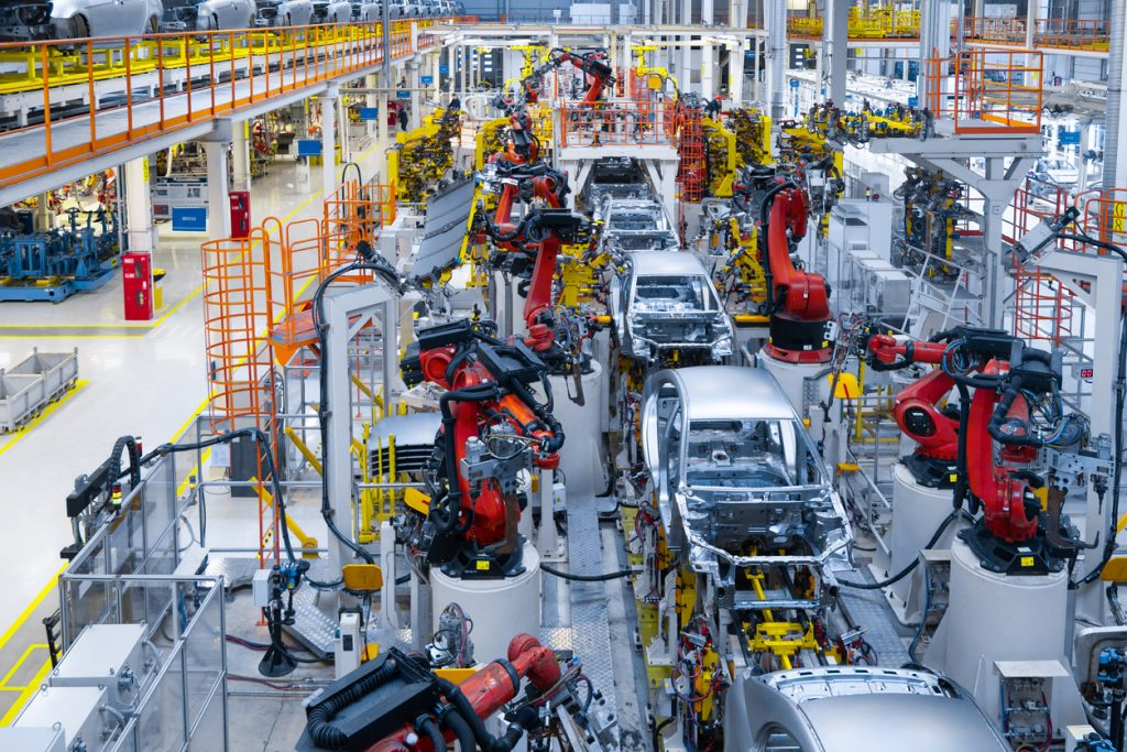 Assembly line production of new car. Automated welding of car body on production line. robotic arm on car production line is working