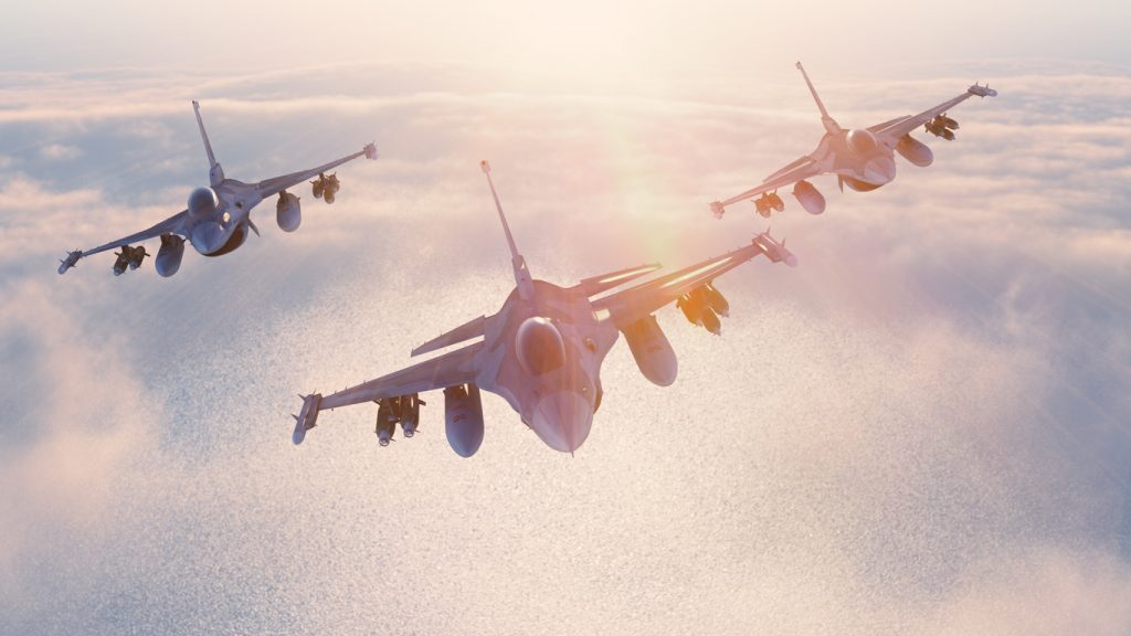 Military fighter planes flying in the sky